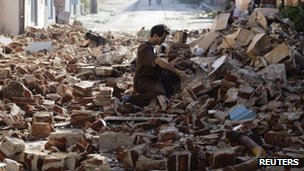 Man salvages bricks in Santiago after Hurricane Sandy hit - 27 October