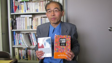 Maekawa holding two of his books