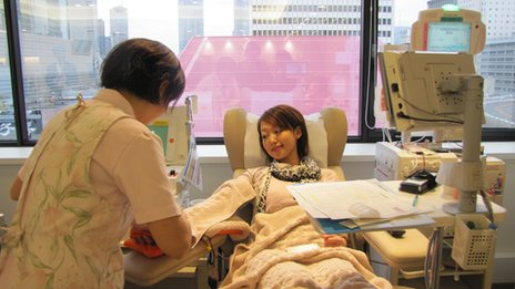 Masako giving blood in hospital