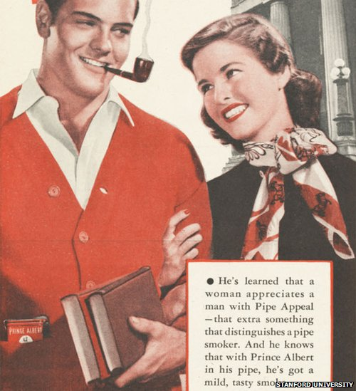 A young attractive man and woman arm in arm, the man smokes a pipe