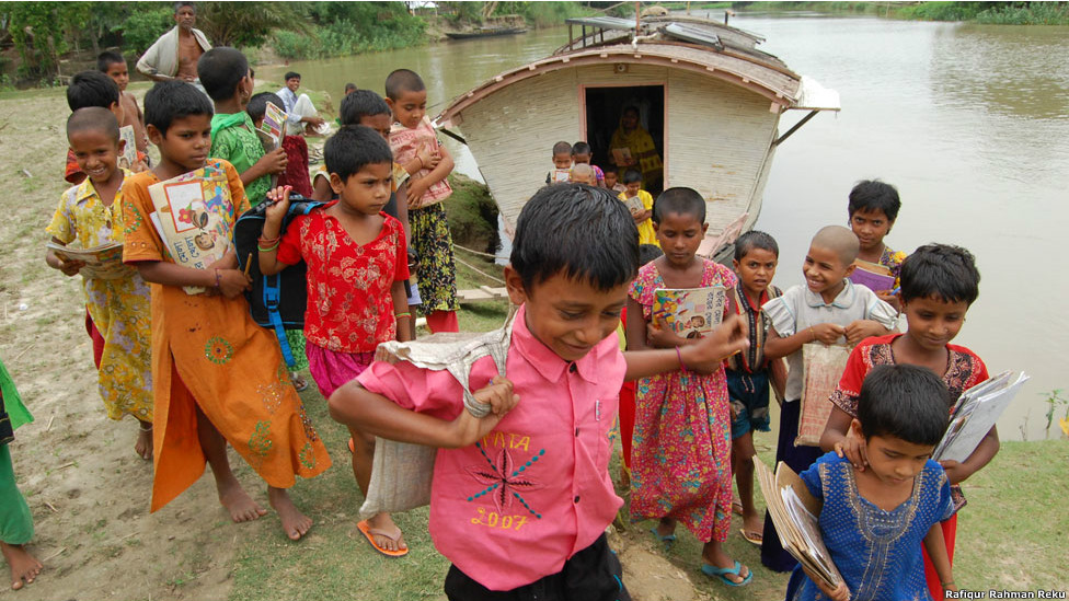Children disembark a floating school
