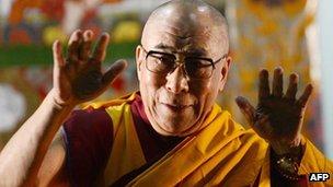 The Dalai Lama gestures prior to start a public teaching in Yokohama, Japan, 04 Nov 2012