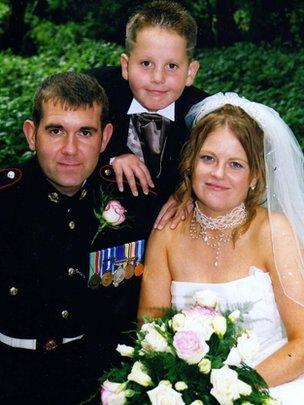 Sgt Steve Johnson and Staff Sergeant Karen Johnson, with Karen's son