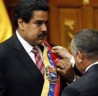 Nicolas Maduro receives the sash of office from National Assembly Speaker Diosdado Cabello