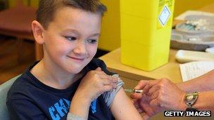 Boy getting measles jab