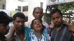 Kamola Begum (C) whose husband was killed in the building collapse