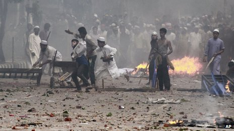 Bangladeshi protesters throw stones at police during a protest in Dhaka, 5 May 2013