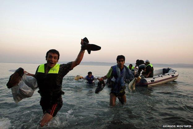 Syrian refugees clamber ashore, Lesbos