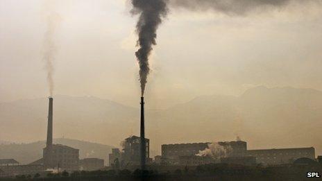Smoke rising from factory chimneys