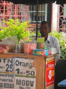Konan Kouassi Vercruysses behind his phone booth in Abidjan