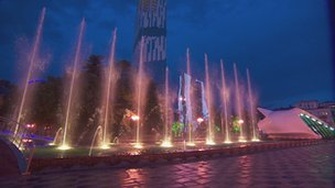Batumi's dancing fountains in tune to the music with the Alphabet tower in the background.
