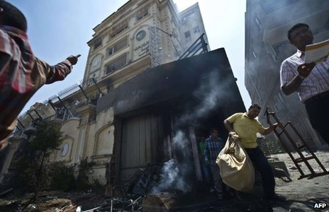 Protesters outside the Muslim Brotherhood's headquarters in Cairo on 1 July 2013