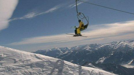 Skier on a ski lift in Georgia's Caucasus mountains