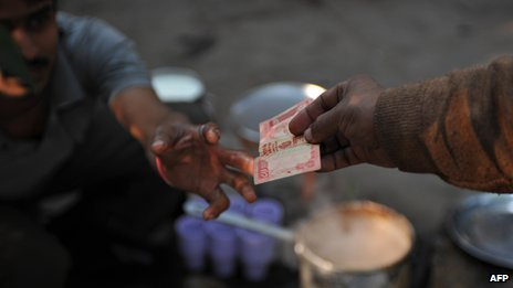 Man paying for tea, India