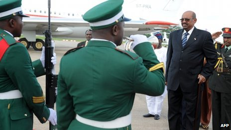 Sudan's President Omar al-Bashir reviews the troops as he arrives at the Nnamdi Azikiwe International Airport in Abuja on 14 July 2013