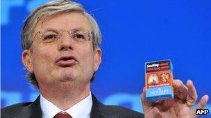 EU Commissioner Tonio Borg with cigarette pack, 19 Dec 12