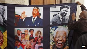 A banner with images of former South African president Nelson Mandela is hung inside the St George's Cathedral in Cape Town, on 17 July 2013