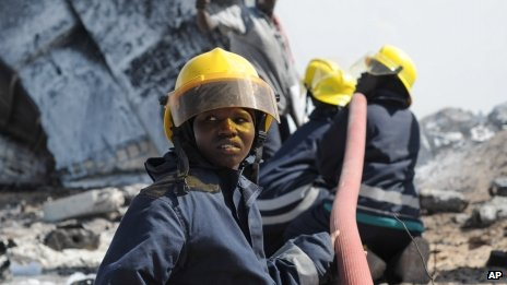 In this handout photo released by African Union Mission in Somalia (AMISOM), AMISOM firefighters attempt to extinguish the fire at the site of an airplane crash in Mogadishu, Somalia, Friday, 9 August. 2013.