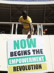 "Sign saying: ""Now begins the empowerment revolution"""