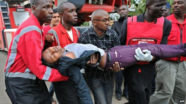 Woman who had been held hostage is carried out of the Westgate centre, Nairobi (21 September)