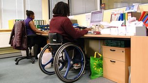 Wheelchair user in an office