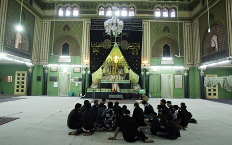 Indian Shiite Muslims take part in religious prayers at 'Ashoorkhana' in the Aza Khana Zehara in Hyderabad, on January 5, 2009. The structure, built by the seventh Nizam Mir Osman Ali Kahan to perpetuate the memory of his mother Amtul Zehra Begum