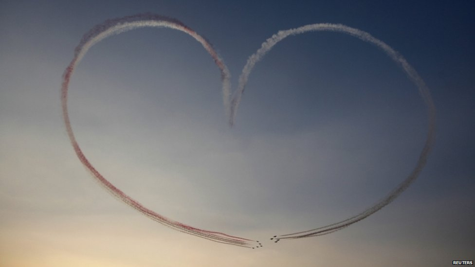 Military aircraft participate in a flying display over Tahrir Square as Egypt celebrates the anniversary of the 1973 Arab-Israeli war in Cairo