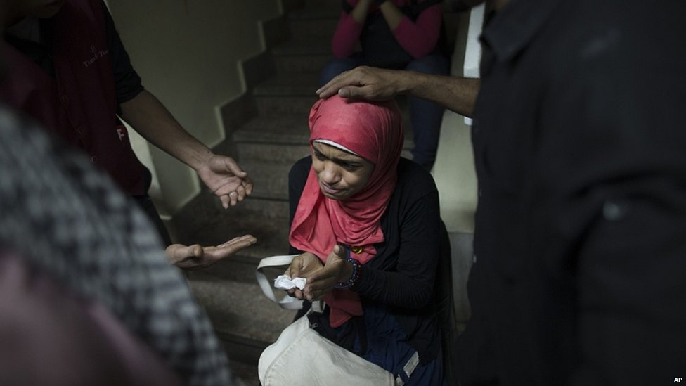 Supporters of Egypt's ousted President Mohammed Morsi comfort a relative of victim of clashes with security forces in Cairo