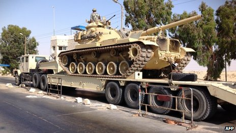 An Egyptian military tank is deployed in the northern Sinai town of Al-Arish (file photo)