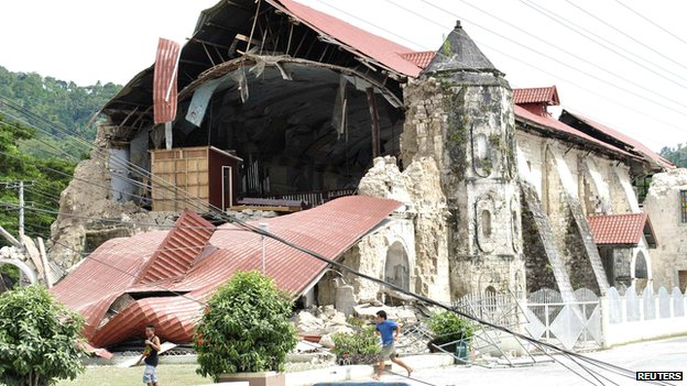 The collapsed facade of the San Pedro y San Pablo church in Loboc town, Bohol province