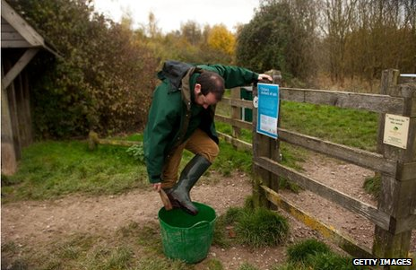 Woodland Trust worker disinfects his boots at Pound Farm Woodland