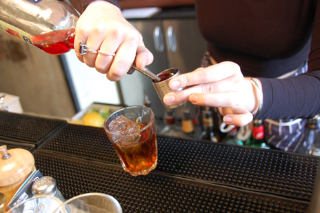 bartender pouring bitters