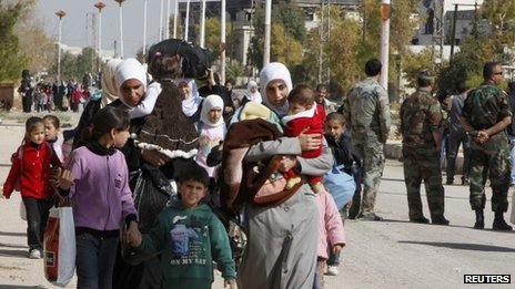 Syrian families leave their besieged town
