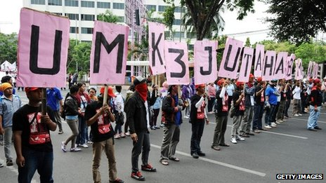 Protesters march down the road in Surabaya