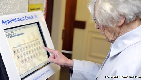 A patient using the automatic appointment check-in screen