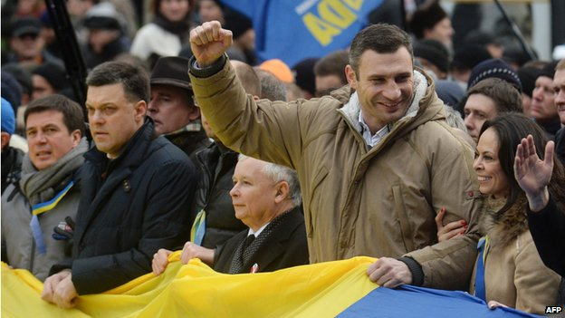 Boxer and politician Vitali Klitschko with raised fist at rally in Kiev, 1 Dec 13
