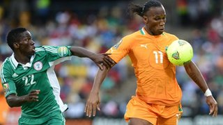 Nigeria's Kenneth Omeruo (left) tries to tackle Ivory Coast's Didier Drogba