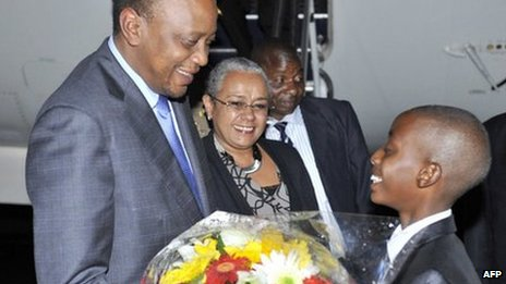 Kenya's President Uhuru Kenyatta arrives at Waterkloof Airforce Base in Pretoria on December 9, 2013 to attend the memorial service of former South African President Nelson Mandela tomorrow