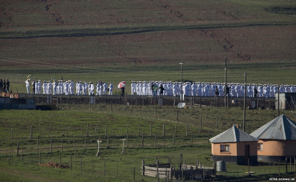 Members of the South African Navy line the road from the Mandela family house to his burial site in Qunu
