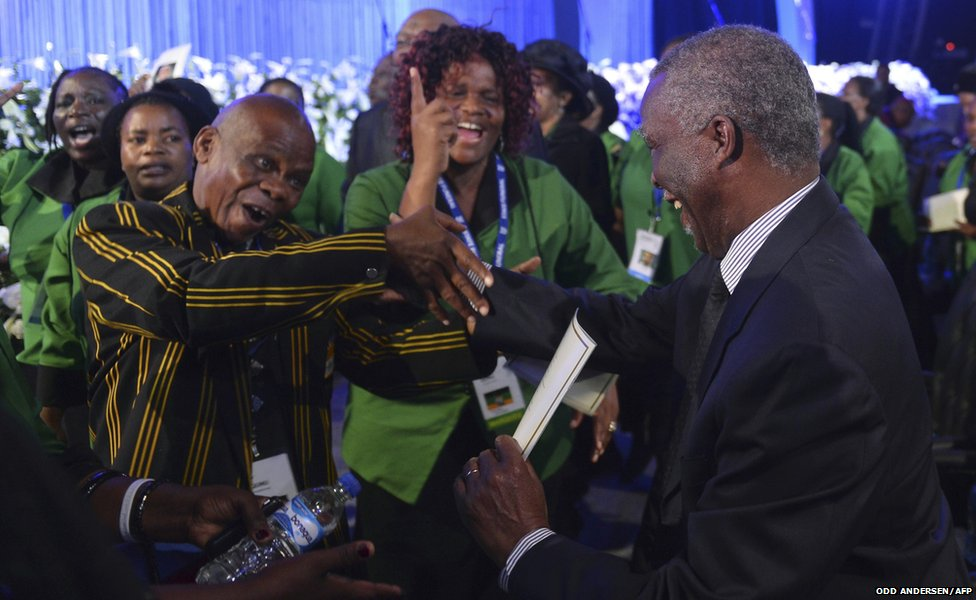 Former South African President Mbeki is greeted by ANC supporters