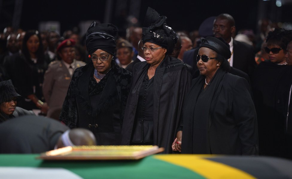 The ex-wife of Nelson Mandela, Winnie Mandela Madikizela (left), and the widow of Nelson Mandela, Graca Machel (centre)