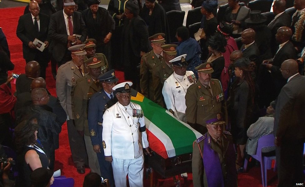 The coffin of former South African President Nelson Mandela is carried by military personnel