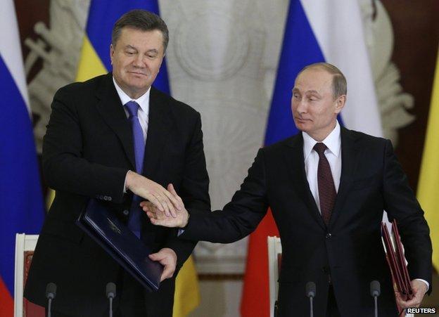 Ukrainian President Viktor Yanukovych (left) shakes hands with Russian President Vladimir Putin at the Kremlin, 15 December