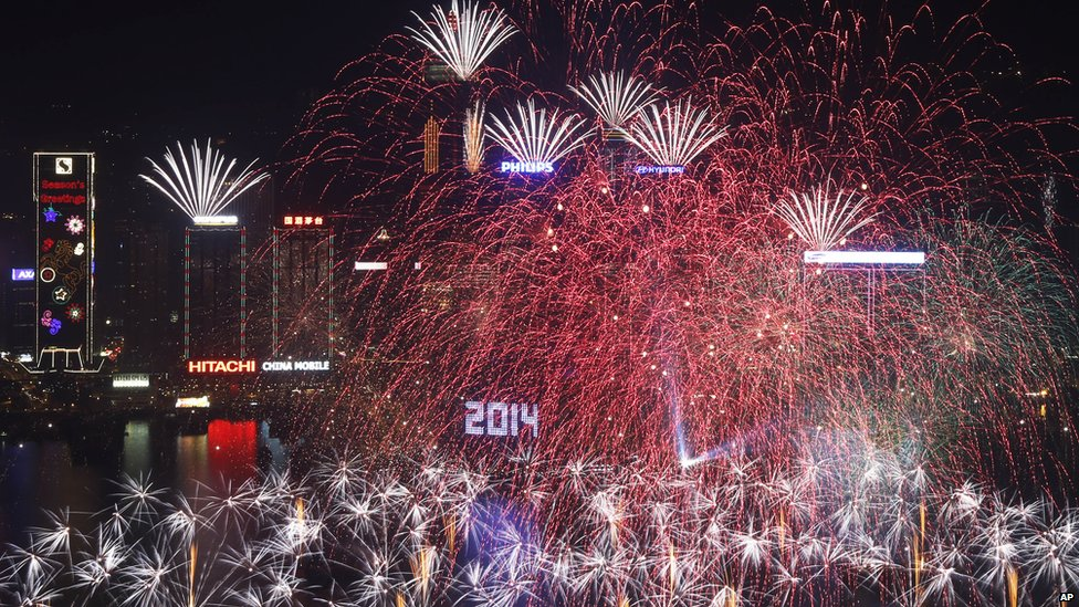 Fireworks explode at the Hong Kong Convention and Exhibition Centre over the Victoria Harbor (1st January 2014)