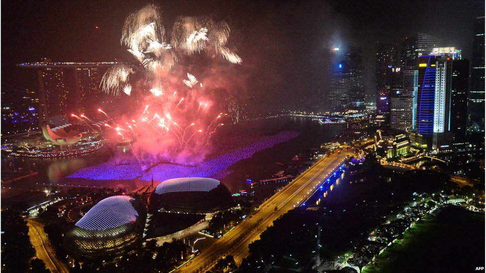 Fireworks burst over the Singapore skyline during New Year celebrations on January 1, 2014