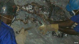 Miners chisel loose Tungsten ore near Kigali in Rwanda.