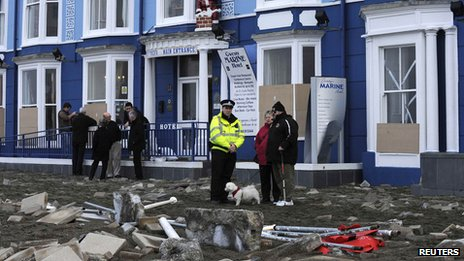 Storm damage is seen on the promenade at Aberystwyth