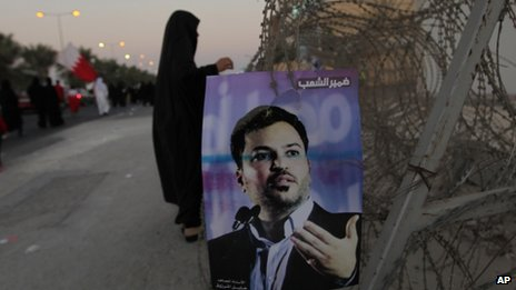 "Arabic writing on the poster reads, ""Conscience of the people,"" with a picture of jailed opposition figure Khalil Marzooq in Manama, Bahrain (September 2013)"