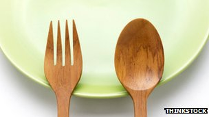 A plate, fork and spoon