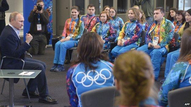 Russian President Vladimir Putin speaks to Olympic volunteers in Sochi, 17 January